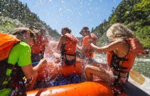 Rafting on the Rogue River rapids, being splashed - First person view.