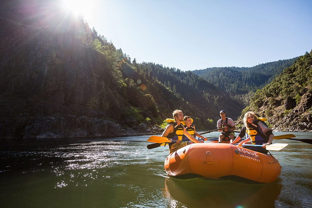Sunny morning floating down the Rogue River in a raft.