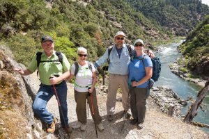Picture of friends hiking the Rogue River Trail in summer.