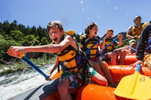 Kids having fun rafting on the Rogue River