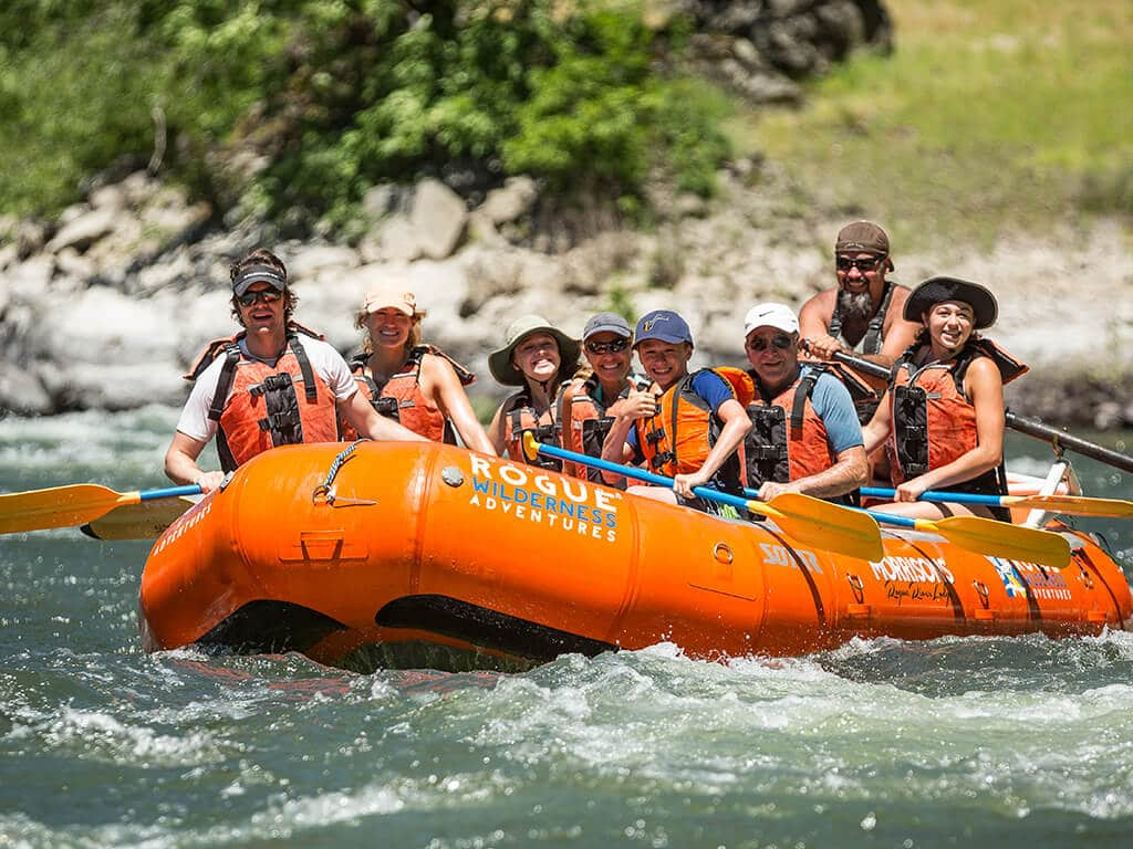 Family rafting down the Rogue River on a guided trip with Morrisons Rogue Wilderness Adventures
